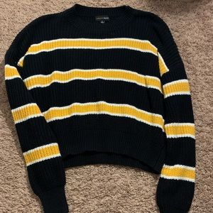 black and yellow sweater